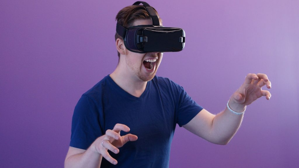 Man playing a game with VR set