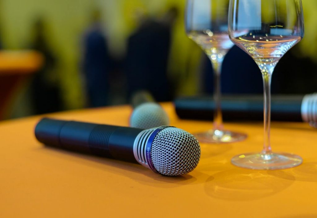 Microphone on top of the table near glass